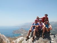 Family on mountain with view on Plakias, Crete
